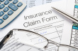 stock-photo-15822982-handwritten-insurance-claim-form-with-pen-and-calculator.jpg